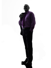senior business man standing looking up silhouette