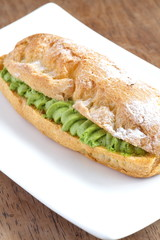 Fresh eclairs filled with green tea cream
