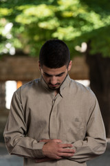 Young Muslim Guy Praying