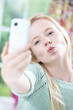 Teenage Girl Taking Selfie On Mobile Phone