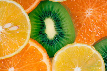 Fruit slices background (lemon, kiwi, tangerine)