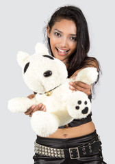 cheerful girl with teddy bear