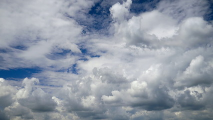 White clouds running over blue sky. Time lapse