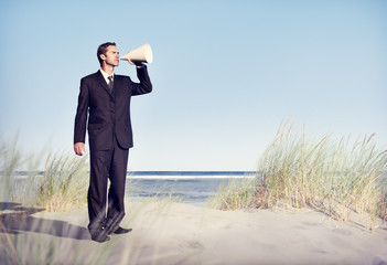 Business Man Holding loudspeaker on Beach