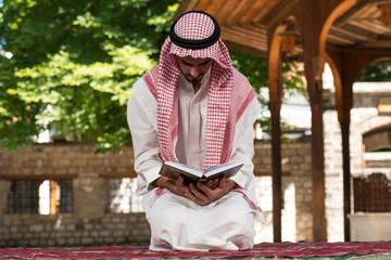 Young Muslim Guy Praying