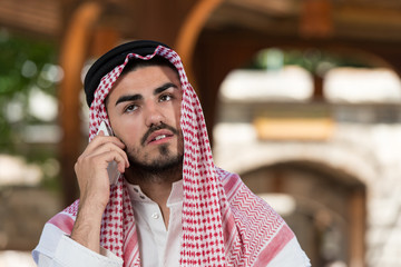 Handsome Middle Eastern Man Talking On Mobile Phone