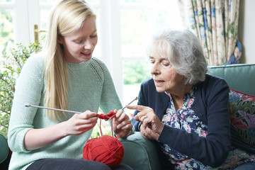 Grandmother Showing Granddaughter How To Knit