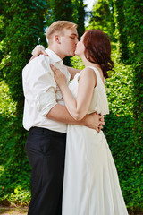 Newlywed couple kissing. Groom and bride wedding day kiss.