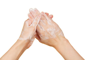 Hands in the foam of soap
