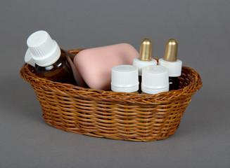 Shampoo, gel, soap in basket for hotel