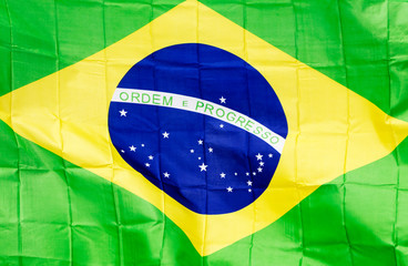 Brazilian flag in the wind in unlight