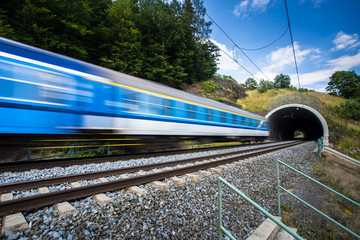 Fast train passing through a tunnel on a lovely summer day