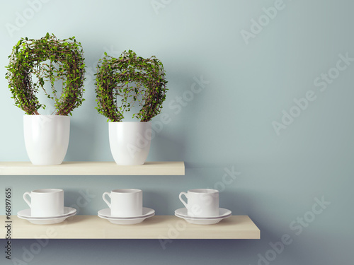 Cups and flowerpot on the shelf.
