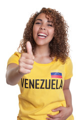 Young woman from Venezuela showing thumb
