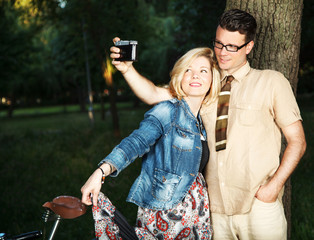 Happy young couple taking self-portrait photos
