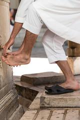 Muslim Washing Feet Before Entering Mosque