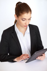Businesswoman working at tablet pc