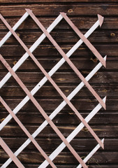 wooden lattice against the wall of a country house