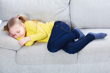 Little girl sleep on sofa in casual