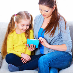 Mother and daughter using tablet PC