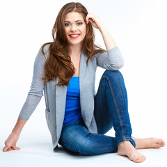Young beautiful woman posing on white floor.