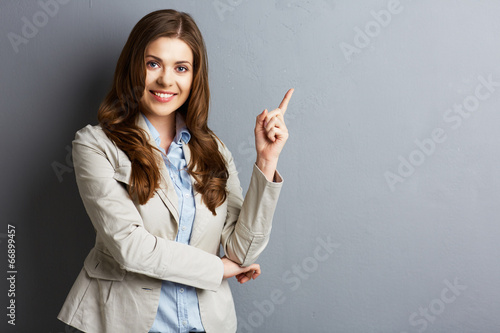 Portrait of smiling business woman pointing finger - 66899457