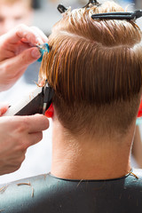 men's haircut with clipper in the barber shop