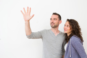 Couple using imaginary touchscreen interface