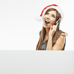Operator call center woman , christmas Santa hat .