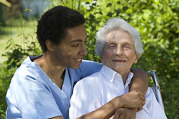 Senior woman with her very embracing and caring caregiver
