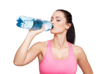 Sporty brunette woman drink water