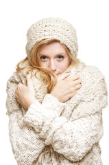 Young woman looking cold and holding her scarf