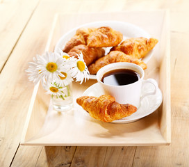 coffee and croissants with daisy flowers