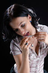 Woman Licking a Cannabis Joint