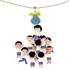Group of young boys playing Dahi-Handi on the eve of janmastami