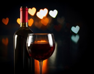 wine glass near bottle, concept of valentine's day