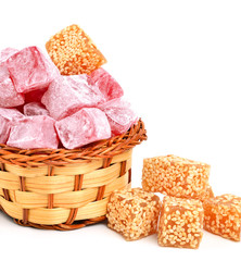 Turkish sweet delights in icing sugar in the basket isolated on