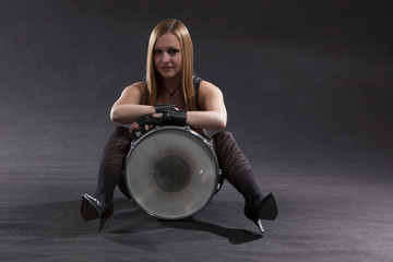 Young Woman Sitting With Drum