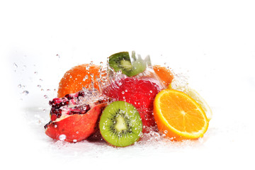 slices of kiwi,  orange, pomegranate and  lemon