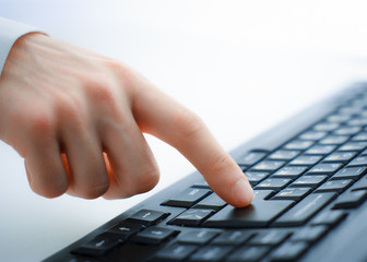 Male office worker typing on the keyboard