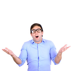 Portrait of confused clueless young man against white background