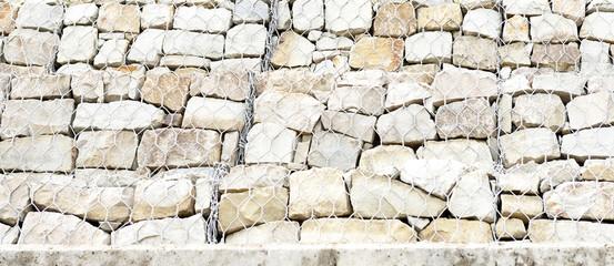 many stones in metal mesh