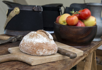 bread and knife with tomatoes on background