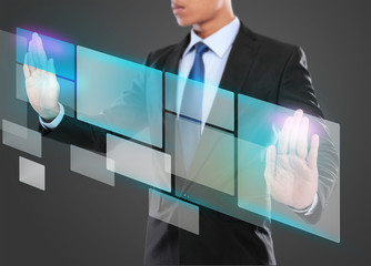 Businessman pressing virtual media button