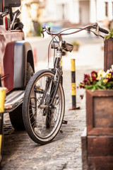 photo of vintage bike parked on old street
