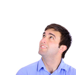 Portrait of happy handsome young man looking up isolated on whi