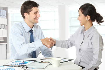 Interviewer shaking hand to future employee