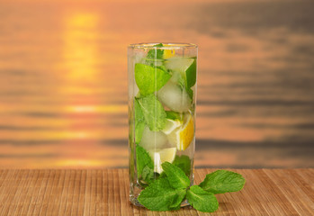 Glass with mojito and spearmint leaf