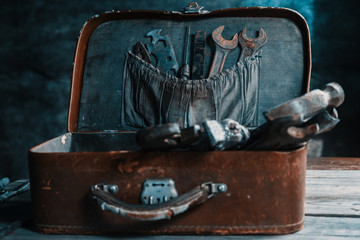 Old working tools in suitcase