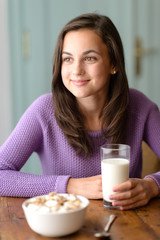 Thinking teenage girl enjoy healthy breakfast